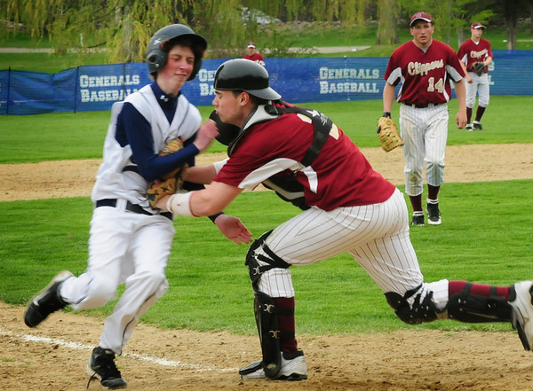 Hamilton: Newburyport catcher Jimmy Conway tags Hamilton-Wenham's Jack Keegan out at the end of the ninth inning to give Newburyport the win and Coach Bill Pettingell his 600th win. Bryan Eaton/Staff Photo