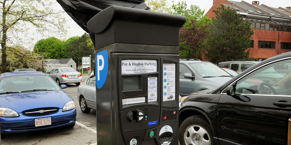 Newburyport: Signs and payment kiosks are covered up in the Green Street parking lot in downtown Newburyport, this one visible due to strong wind. They will be in use in the next couple weeks. Bryan Eaton/Staff Photo