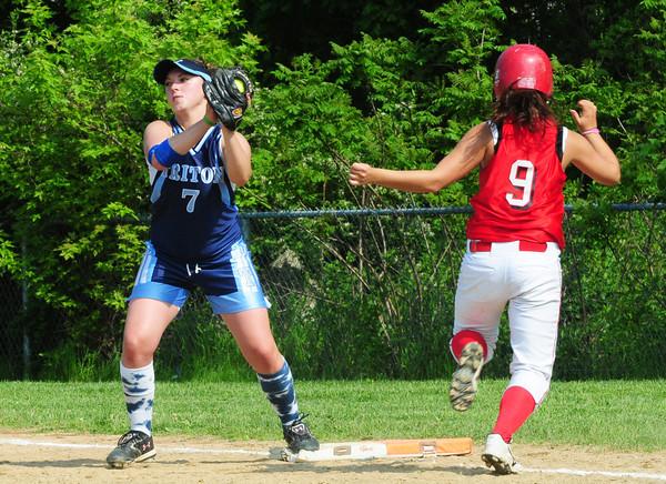 Amesbury: Triton first baseman Shannon Sinton makes the catch before Amesbury's Laura Kaminski makes it to the base. Bryan Eaton/Staff Photo