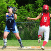 Amesbury: Triton first baseman Shannon Sinton makes the catch before Amesbury's Laura Kaminski makes it to the base. Bryan Eaton/Staff Photo