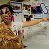 Newburyport: Dressed as a Maori warrior from New Zealand, Ryan Tamayoshi, 12, talks about the country he chose to research at the Nock Middle School for their International Tourism Expo on Thursday. He chose New Zealand because it's a country he hopes to visit someday. Bryan Eaton/Staff Photo