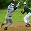 West Newbury: Triton's Blaise Whitman tries to make it to second as Pentucket second baseman throws to first for a double play. Bryan Eaton/Staff Photo