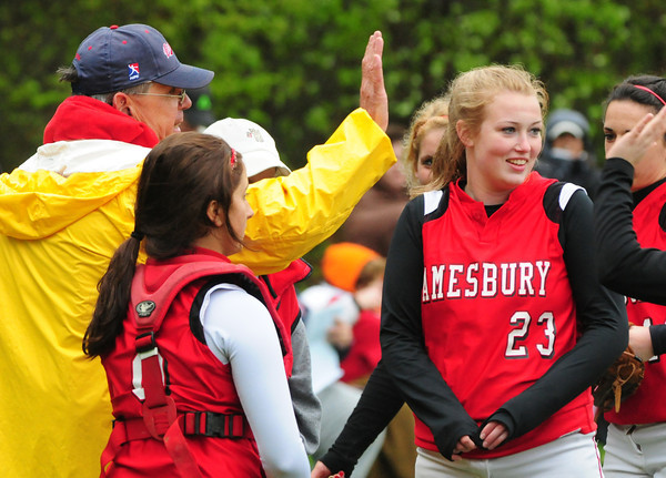"Lynnfield: Amesbury softball coach Chris Perry gets ""high-fived"" by team members on his 500th win in Lynnfield yesterday. Bryan Eaton/Staff Photo"