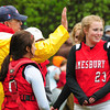 """Lynnfield: Amesbury softball coach Chris Perry gets """"high-fived"""" by team members on his 500th win in Lynnfield yesterday. Bryan Eaton/Staff Photo"""