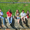 Newburyport: Students hang out on the wall watching the Newburyport Clippers take on North Andover at a sunny Lower Field yesterday afternoon. Bryan Eaton/Staff Photo