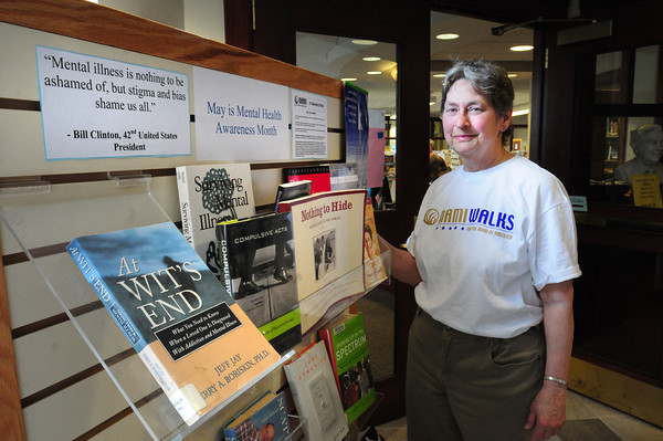 Newburyport: May is National Mental Health Month and the local chapter of the National Alliance on Mental Illness is hosting a speaker this weekend, and putting up a display of books on the topic at the library, here with acting president Joyce Cejka. Bryan Eaton/Staff Photo
