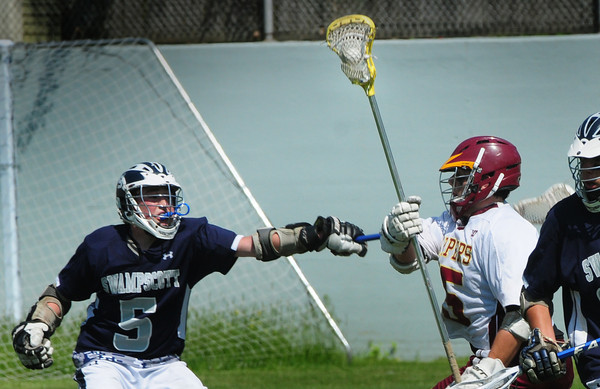 Newburyport: Newburyport's Alex Fiorito gets pressure from a Swampscott player. Bryan Eaton/Staff Photo