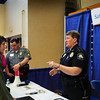 "Byfield: Triton students John O'Neil, left, and Carlina Arango, both 17, talk to Topsfield police Sgt. Richard LaBel and Newburyport police office Nora Duggan at the Credit for Life Fair at the school. Students play the roles of 25-year old adults and are ""assigned"" professions and annual salaries. Then working within a budget based on their monthly ""income,"" the students visit 14 booths over a 3 hour period to make ""purchase"" decisions utilizing cash, credit or savings. Bryan Eaton/Staff Photo"