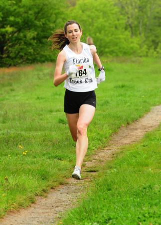 Newburyport: Betsy Suda is the second female to cross the finish at Trav's Trail Run on Sunday. Bryan Eaton/Staff Photo