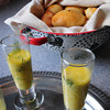 Cynthia  Flahardy's Dill Pickle Soup Shooters with Cabbage-filled yeast Pierogi Rolls in her grandmother's old colander. Bryan Eaton/Staff Photo