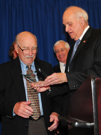 Georgetown: Former Newburyport mayor and lifelong friend, Byron Matthews, right, presents former Daily News editor Bill Plante with the Edward Molin Community Leadership Award at the Greater Newburyport Chamber of Commerce and Industry Annual Luncheon. Bryan Eaton/Staff Photo