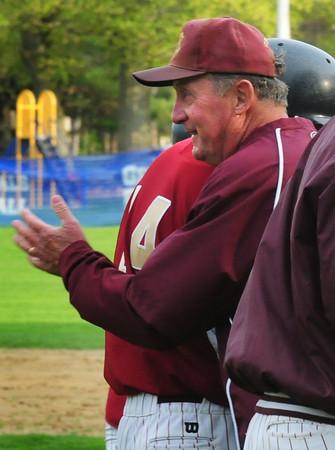 Hamilton: Newburyport High baseball Coach Bill Pettingell pats Ryan O'Connor as he comes in from scoring a grand slam. Bryan Eaton/Staff Photo