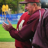 Hamilton: Newburyport High baseball Coach Bill Pettingell pats Ryan O'Connor as he comes in from scoring a grand slam. Bryan Eaton/Staff Photo