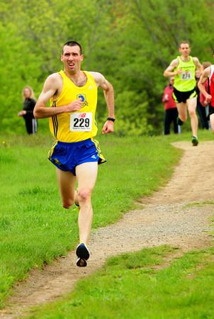 Newburyport: Matt Ely of Natick wins the Trav's Trail Run. Bryan Eaton/Staff Photo