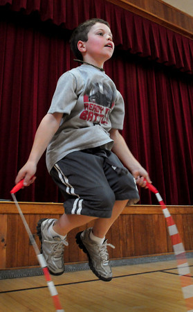 """Newburyport: Nick Salvatore, 9, jumps rope in Kathy Hill's gym class at the Bresnahan School in Newburyport on Tuesday morning. The children have been trying to beat their previous number of jumps as the theme of the week at the school is """"Be Your Personal Best."""" Bryan Eaton/Staff Photo"""