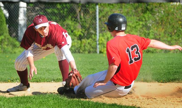 Newburyport: Newburyport second baseman Coltin Fontaine tags North Andover's Alec Jillson out at second base. Bryan Eaton/Staff Photo