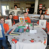 Amesbury: Teen leader hold artwork for Saturday's fundraiser for Lucy's Love Bus, a fund created after the death of 12-year-old Lucy Grogan of cancer.  Infront from the left are Ali Pelletier, Jane Grogan, Jackson Harris, Katy O'Neill and Signe Frick, back Jason Grissino, Evan Grissino, Isabel Prussman and Caroline Logan. JIm Vaiknoras/staff photo