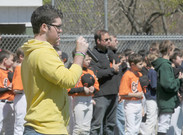 Beverly:Aaron Swiniuch sings the National Anthem the Opening Day ceremonies for the Beverly Little League at Harry Ball Field Sunday morning. The boy play for the farm team the Rock Hounds. Jim Vaiknoras/Staff photo