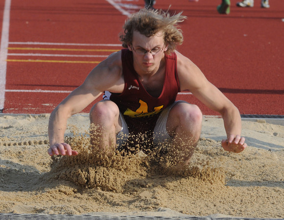 North reading: Newburyport's Ryan Dionne competes in the long jump at the Div 4 championship at North Reading High. Jim Vaiknoras/staff photo