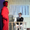 Newburyport: Joe Boyd , played by Hunter Goldthorpe, makes a Faustian bargain with Applegate, played by Matt Tolley in the Newburyport high production of Damn Yankees. Jim Vaiknoras/Staff photo