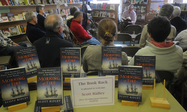 "Newburyport: Author Scott Ridley reads from his book "" Morning of Fire"" at the Book Rack Saturday as part of the Newburyport Literary Feastival. Jim Vaiknoras/Staff photo"