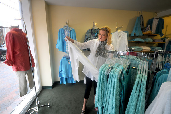 Newburyport: Kathy Johannes put out some dresses at Clay on State Street in Newburyport. JIm Vaiknoras/Staff photo