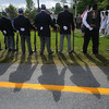 Seabrook: The firing sqaud cast long shadows in the morning light at the Seabrook Memorial Day ceremony Sunday morning at Town Hall. Jim Vaiknoras/Staff photo