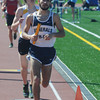 Peabody: Hamilton-Wenham's Chris Benevento runs in the 4x1 mile race at  the Mass. State Track Coaches Relays Sunday at Bishop Fenwick. Jim Vaiknoras/Staff photo