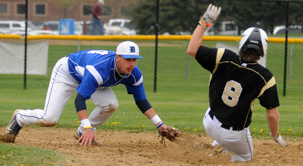 Peabody:  Danvers' Nick Gikas tags Bishop Fenwich's Chad Lassard on a forceout at 2nd during their game at Fenwich Sunday. Jim Vaiknoras/staff photo