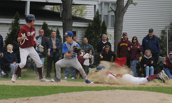 Georgetown: Newburyport's Drew Carter slides into 3rd as<br /> Georgetown's Will Ingraham tags out Brett Fontain on a base running error during their game at Georgetown Saturday. Jim Vaiknoras/Staff photo