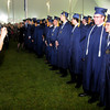 Danvers: Donna Jenkins takes a photo of her son Andrew and his some of his fellow graduates at St John's commencement Sunday morning. Andrew will be attending Middlebury in the fall. Jim Vaiknoras/Staff photo