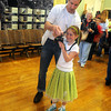 "Amesbury: Anna Penny , 9, of Amesbury , takes some photos of her friends at a pre father daughter dance  promenade at Amesbury city hall Friday night. Over 100 girls and their dads later attended "" A 1950's Sock Hop"" at the Cashman School/ Jim Vaiknoras/Staff photo"