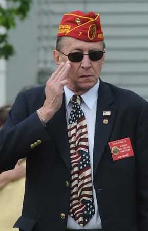 Seabrook: Roland Patnode jr salutes during the National Anthem at the Seabrook Memorial Day ceremony Sunday morning at Town Hall. Jim Vaiknoras/Staff photo