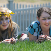 Amesbury: Abbey Nelson of Topsfield and Sarah Paullis of Newton NH both sophmores at the Sparhawk School in Amesbury lay in the grass  at thee schools May Day celebration Friday . JIm Vaiknoras/Staff photo