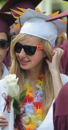 Byfield: Elisa Bradley of Byfield decorated herself in flowers and sunshine  at the 248th of the Governor's Academy in Byfield Sunday. Jim Vaiknoras/Staff photo