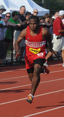 North reading: Amesbury's Dalante Castle competes in the 100m dash at the Div 4 championship at North Reading High. Jim Vaiknoras/staff photo