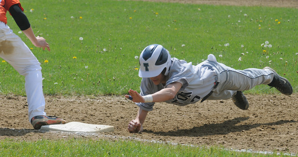 Rowley: Triton's Jarrod Mullen dives safely back to first during teh Viking's game against Ipswich at Eiras Field in Rowley Saturday. Jim Vaiknoras/Staff photo