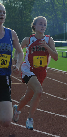 North reading: Amesbury's Megan Kelly competes in the 400m run at the Div 4 championship at North Reading High. Jim Vaiknoras/staff photo
