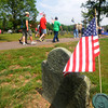 Rowley: People file by the grave of Captain Samual Pickard, a veteran of the Revolutionary War, in Town Cemetary during the Rowley Memorial ceremony. Jim Vaiknoras/Staff photo