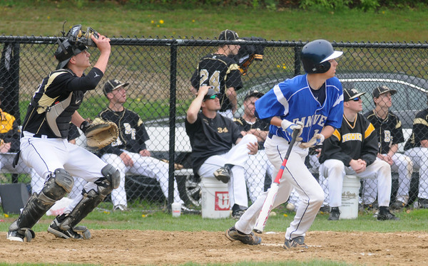 Peabody: Bishop Fenwich's looks up as Danvers' AJ Kuoto hits a long fly out  during their game at Fenwich Sunday. Jim Vaiknoras/staff photo
