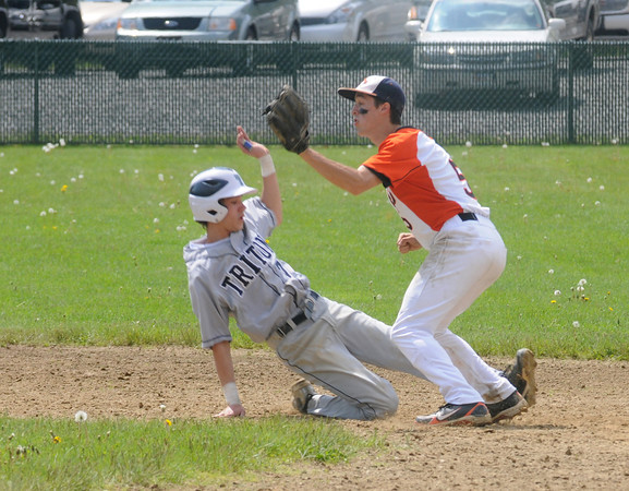 Rowley: Triton's Jarrod Mullen slides back to second under the tag of Ipswich's Lou Galanis during the Viking's game against Ipswich at Eiras Field in Rowley Saturday. Jim Vaiknoras/Staff photo