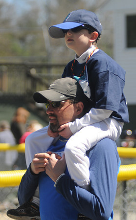 Beverly:Nicholas Corneau, 6, who plays T-ball for the Raptors gets a ride on his dad Rob's shoulders at the Opening Day ceremonies for the Beverly Little League at Harry Ball Field Sunday morning. The boy play for the farm team the Rock Hounds. Jim Vaiknoras/Staff photo