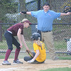 Newburyport: Umpire Mike Abbot calls safe as Morgan Johnston of the Lion's Club slides under the tag of Rotory Club pitcher Lindsay Howard during their game on opening day at the Pioneer League. Jim Vaiknoras/Staff photo