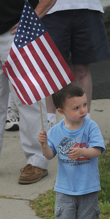 Amesbury: Harrison Allian, 2, holds the flag while he waits patiently for the Amesbury Memorial Day Parade to make it's way down Main Street Monday morning. Jim Vaiknoras/Staff photo