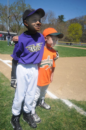 Beverly:Cameron Jones, 8, of the farm team the Bats stand with his neighbor david DiPietro, 8, of the farm team the Grasshoppers at the Opening Day ceremonies for the Beverly Little League at Harry Ball Field Sunday morning. The boy play for the farm team the Rock Hounds. Jim Vaiknoras/Staff photo
