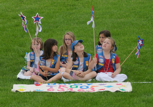 Amesbury: Daisy Troop 63163 relax on the grass at Landry Stadium following the  Amesbury Memorial Day Parade Monday morning. Jim Vaiknoras/Staff photo