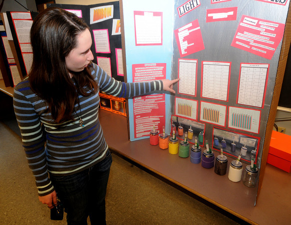 Amesbury: Eighth grader Olivia Castay explains how different colors obsorb and reflect heat during the openhouse at the Amesbury Middle School Thursday night. The event showcased educational projects done by the students.Jim Vaiknoras/Staff photo