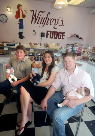 Rowley: The Winfrey children hold their children all born he same week.<br /> from the left, Scott Winfrey with Austin, Jullian Pallazola with Cameron, and Mark Winfrey with Madelyn at the Winfrey's store in Rowley. Jim Vaiknoras/Staff photo