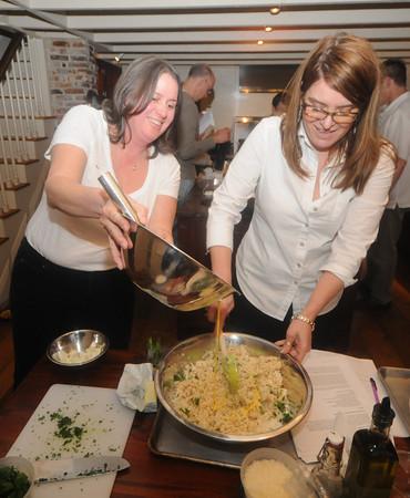 Newburyport Lori Fairbrother and Erica Anderson cook in Kathy Bechtel cooking class at her home in Newburyport. Jim Vaiknoras/Staff photo