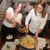 Newburyport Lori Fairbrother and Erica Anderson cook in Kathy Bechtel cooking class at her home in Newburyport. Jim Vaiknoras/Staff photo